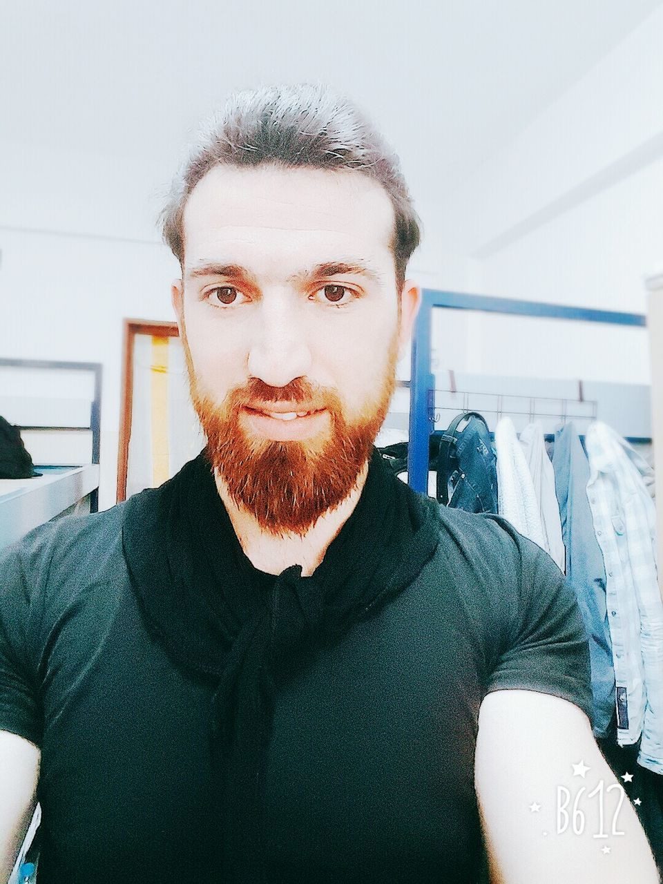 looking at camera, beard, portrait, one person, front view, real people, mid adult men, indoors, casual clothing, standing, young adult, smiling, happiness, lifestyles, day, close-up, people