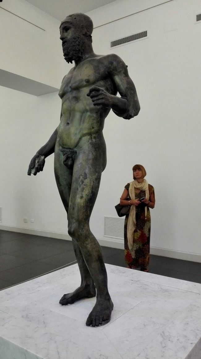 Riace bronzes ReggioCalabria Italy Museo Nazionale Della Magna Greca Bronze Statue Human Representation Sculpture In Front Of Museum People Watching Woman Woman Portrait White Empty Places History Greese Travel Traveling Travel Destinations Travel Photography Face To Face Antient Culture People And Places