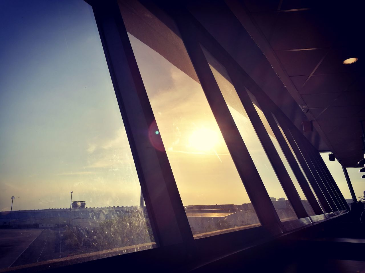 EyeEmNewHere Sunset Silhouettes Relaxing Moments Sunlight Memories Airport Waiting Departure Goodbye