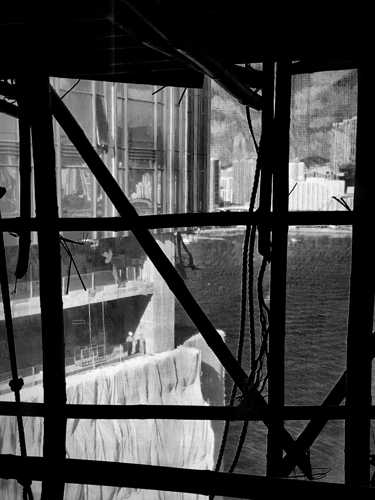 Window Architecture Bamboo Scaffolding Safety Net Hong Kong Building Urban Skyline Black & White Black And White Hong Kong Architecture Monochrome IPhoneography Light And Shadow Pattern, Texture, Shape And Form Architecture Building And Sky Construction Site Behind The Screen Man In Building