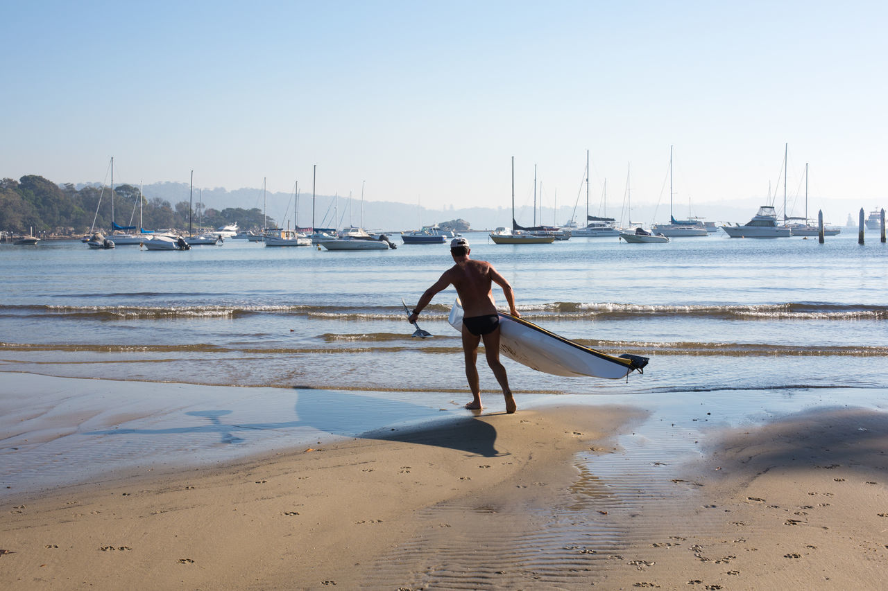 Beautiful stock photos of holiday, Adult, Beach, Blue, Clear Sky