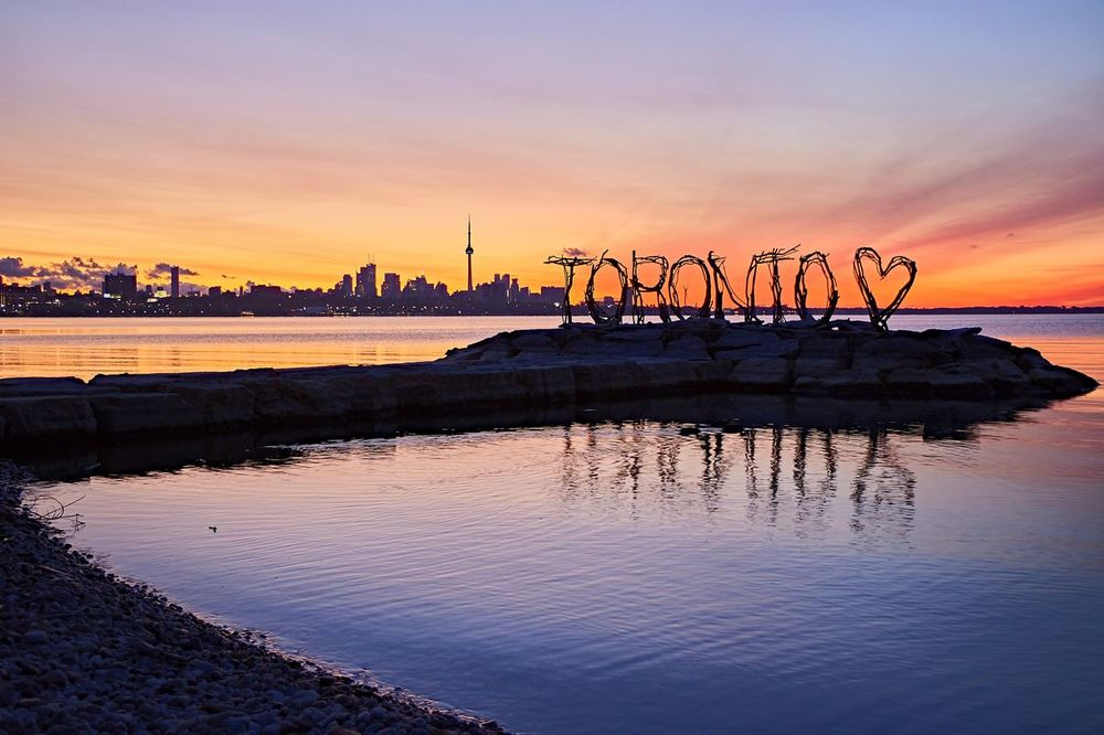 Landscape EyeEm Selects Sunrise Travel Destinations No People Beauty In Nature City Outdoors Water Lake Signage Cntower Bright Sky Cityscape TorontoLove Humber Bay Toronto Lake Ontario