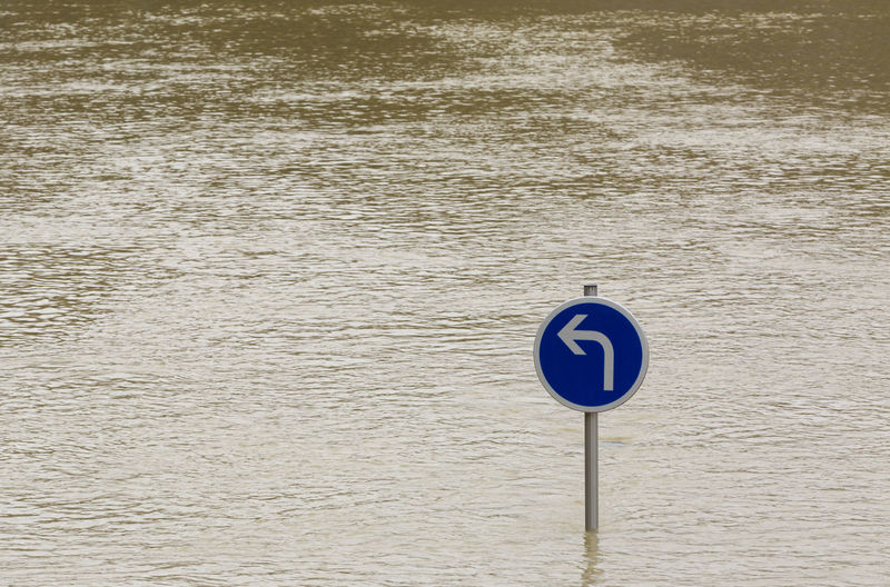 Flood abstract Arrow Global Warming Nature Paris Seine Seine River Transportation Background Blue Direction Disaster Ecology Environment Flood Flooding Guidance Outdoors Pillar River Road Sign Traffic Sign Traffic Signal Turn Left Water