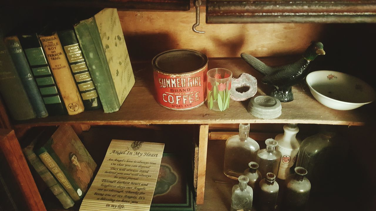 On The Shelf On The Shelves Vintage Treasures Vintage Coffee Can Ecclectic Taking Photos Check This Out Check This Out! Android Photography Eyem Gallery Eyem Market Vintage Books Looking At Things Eyem And Getty Collection Still Life Photography Still Life Rustic Charm Rustic Popular TRENDING  Vibrant Colors Antiques Home Is Where The Art Is