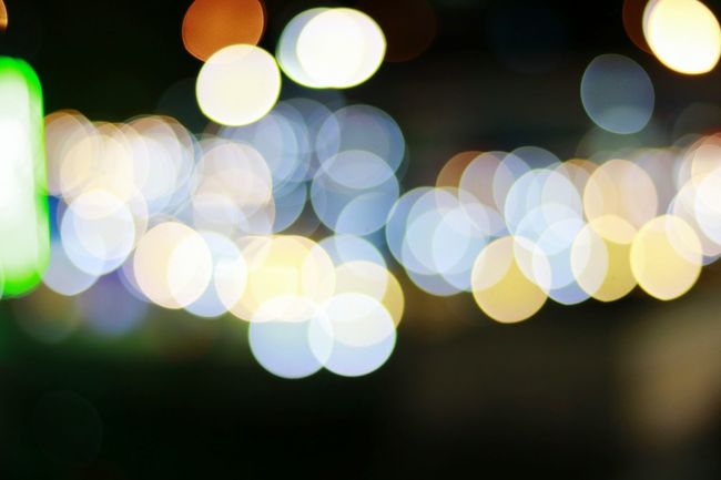 Defocused Illuminated Lighting Equipment Circle Lens Flare Night Abstract Light - Natural Phenomenon Glowing Light Pattern City Life Multi Colored City Outdoors Fairy Lights Electric Light Ideas Blurred Image Focus Technique Bokeh Photography Bokeh Bokeh Lights Fine Art