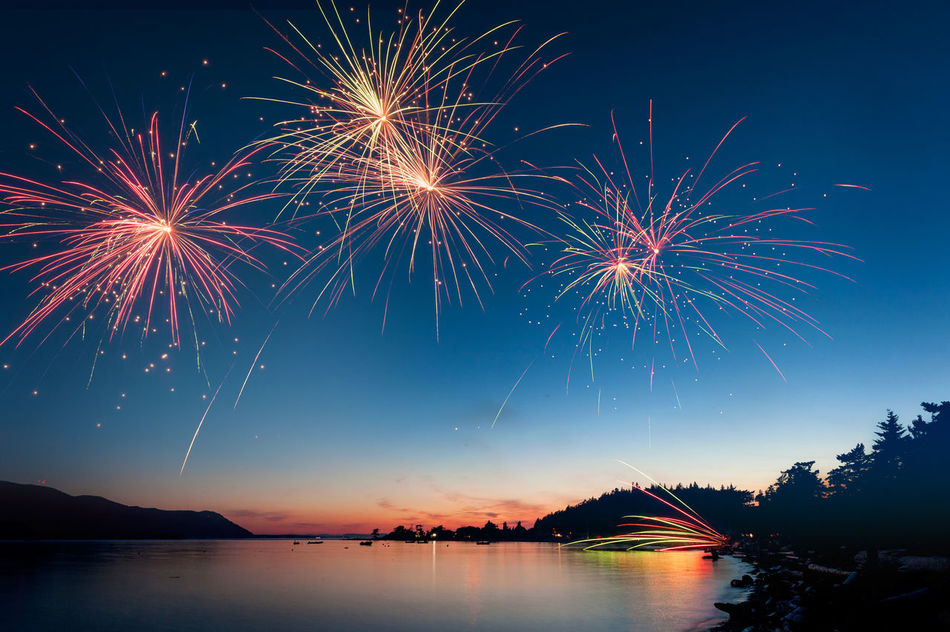 A Fourth of July fireworks display over water on Lummi Island, Washington. 4th Of July Atmospheric Mood Bay Beach Blue Sky Exploding Exploding Fireworks Firework Firework Display Fireworks Fireworks! Fireworksphotography Fourth Of July Lummi Island Orcas Island Pacific Northwest  Puget Sound Pyrotechnic Rural Salish Sea San Juan Islands Sky Summer Sunset Water Market Bestsellers August 2016 Bestsellers
