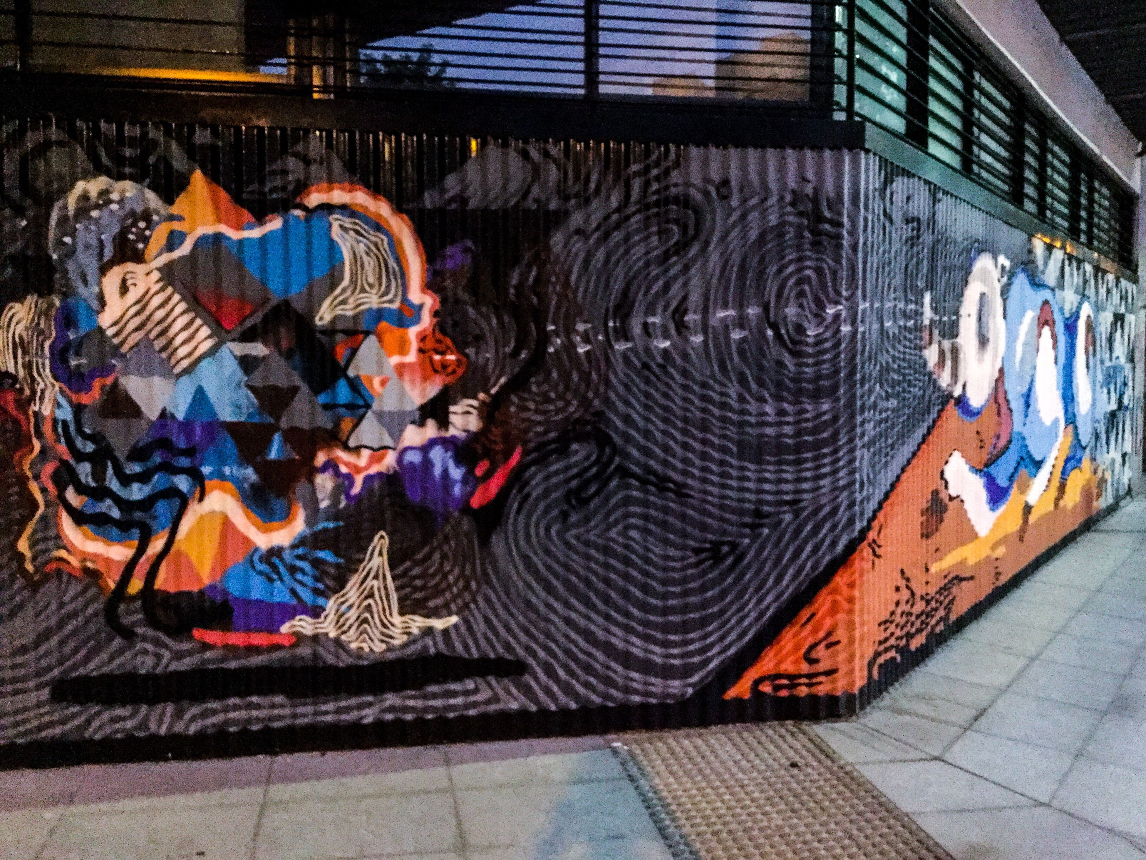 graffiti, art and craft, art, creativity, multi colored, wall - building feature, street art, built structure, human representation, architecture, vandalism, indoors, text, mural, building exterior, day, no people, brick wall, abandoned