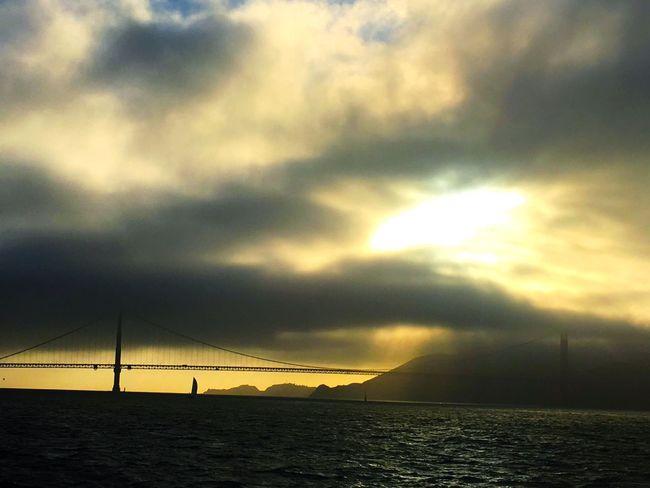 Tranquil Scene Sunset Sky Water Ocean Bridge Golden Gate Bridge SanFranciscoBay San Francisco Sea Fog Sun Rays Cloudy