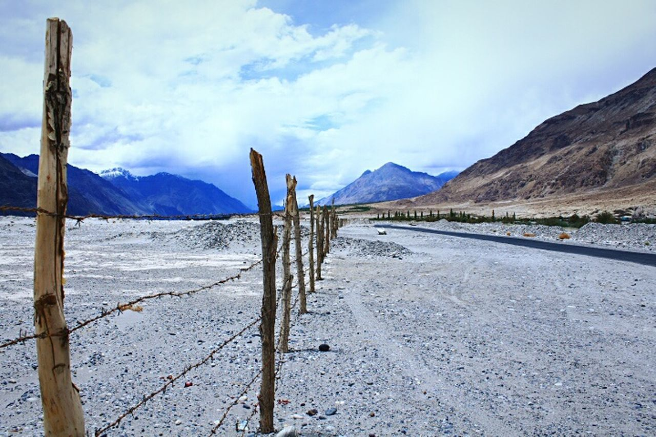 Nubra Valley Jammu And Kashmir Gorgeous View June 2016 Ladakh Original Experiences Ladakh_lovers Travel Photography Fence Mountains In Background Landscape_Collection Feel The Journey Mountainscape Incredible India Clouds And Sky