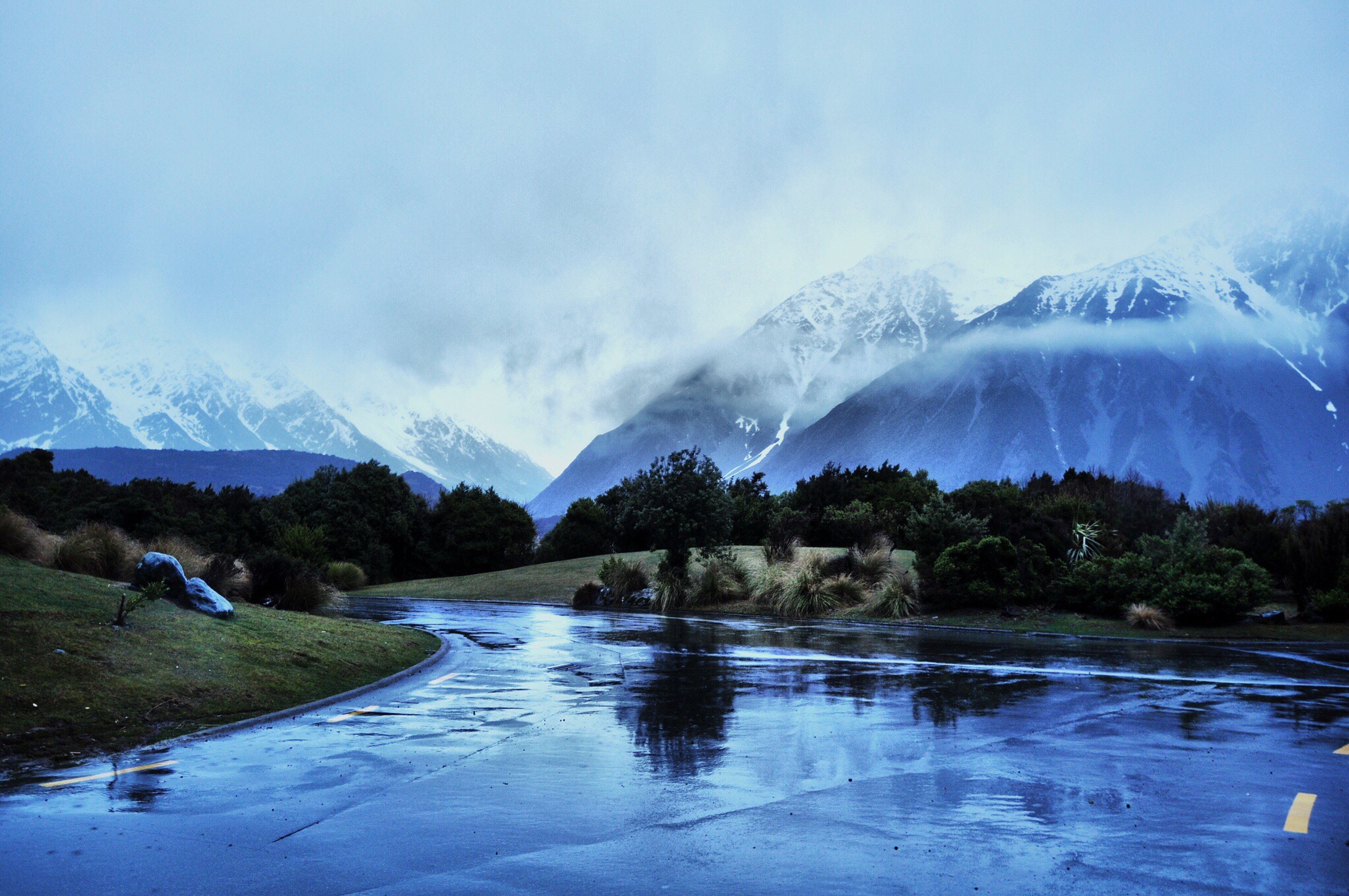 winter, snow, cold temperature, mountain, season, snowcapped mountain, water, scenics, tranquil scene, mountain range, beauty in nature, weather, tranquility, lake, frozen, nature, sky, landscape, covering, non-urban scene