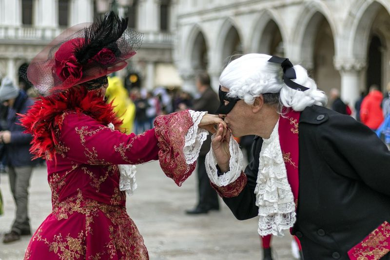 Carnival in Venice 2017 Carnival Disguise Fun Tradition Arts Culture And Entertainment Bonding Carnival - Celebration Event Costume Costumes Kissing Hand Leisure Activity Lifestyles Mask Mask - Disguise Real People Red Togetherness Traditional Clothing Two People Venetian Mask Venice