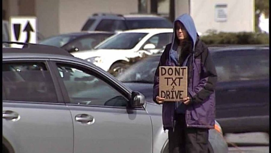 """This is me. That is the sign I flew for panhandling. Photo was taken in April 2013. I was featured on CNN and Yahoo News as """"The People And Places City Life Panhandling Homeless Homelessness  Texting Public Service Announcement Don't Text And Drive"""