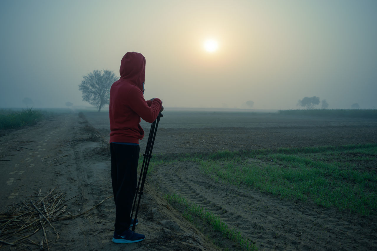 A beautiful morning walk to remember at Rajasthan Adventure Back Farm Fog Healthy Lifestyle Human Back Man Morning Morning Walk Nature Naturelovers One Person Outdoor Pursuit Outdoors Rajasthan Rear View Sunrise Tripod