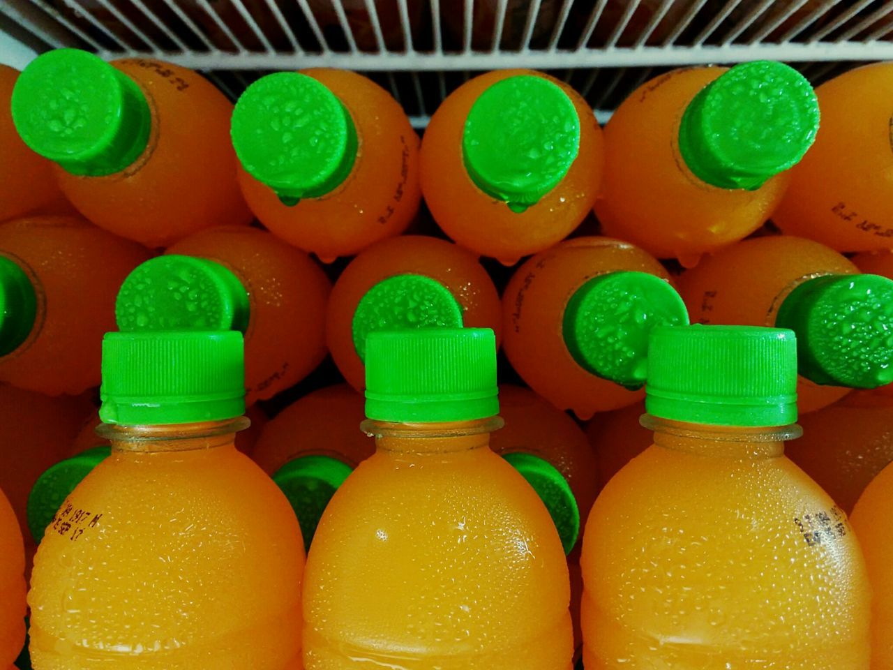 Seriously? What's with them bottles these days? Food And Drink Green Color Bottle Indoors  No People Food Yellow Freshness Cold Colors Color EyeEm Gallery Philippines Eyeem Philippines EyeEm Refrigerator Orange Orange Color Green Green Color Visual Feast Round Circle