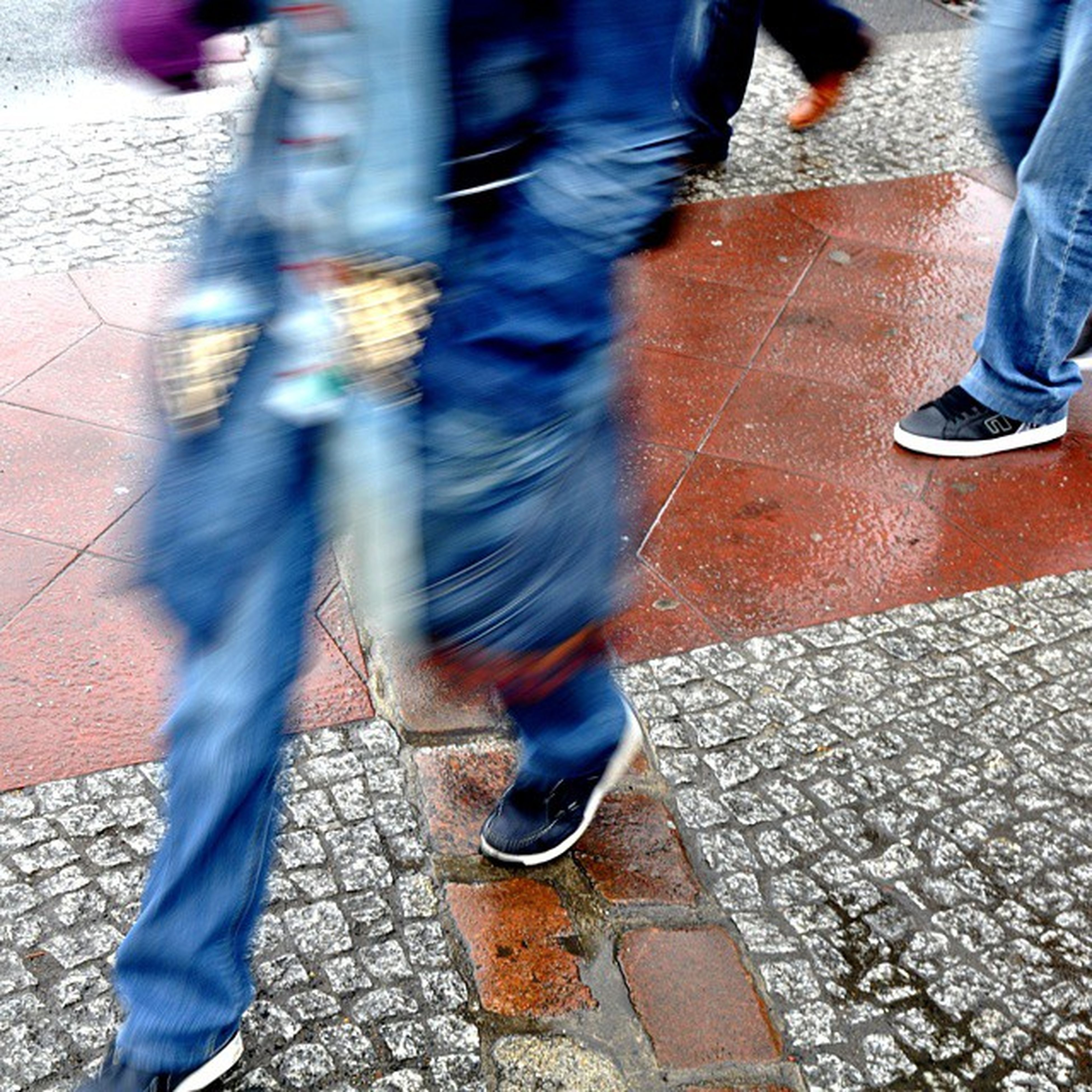 low section, street, person, lifestyles, sidewalk, walking, men, road, high angle view, transportation, standing, shoe, leisure activity, footpath, cobblestone, human foot