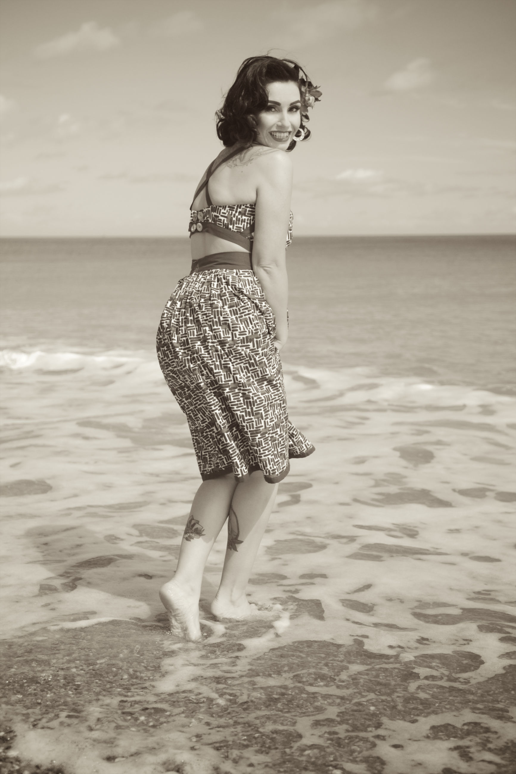 sea, water, young adult, beach, horizon over water, person, young women, full length, lifestyles, leisure activity, shore, vacations, sky, casual clothing, standing, bikini, sand