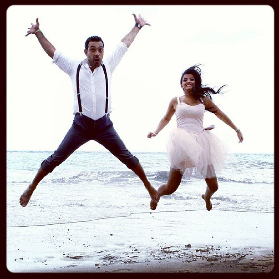 Happy Couple Newly Wedds beach jumping saybs