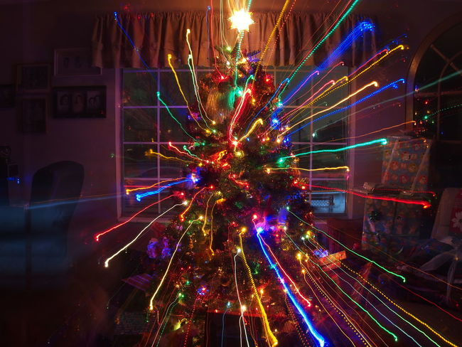 My first attempt at taking a pic with this effect. Celebration Christmas Christmas Decorations Christmas Lights Christmas Tree Christmastime Decoration Epl6 Exposure Fun Glowing Illuminated Indoors  Light Long Exposure Mirrorless Multi Colored Night Olympus OlympusPEN Streak Of Light Streaks Zoom Zoomeffect