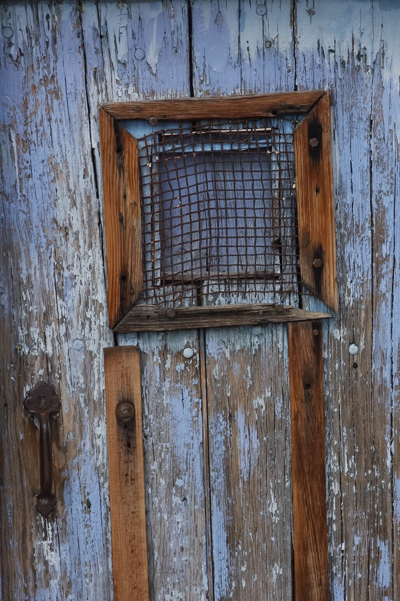 Blue old door, peeling paint, rusty handle, weathered door, antique door