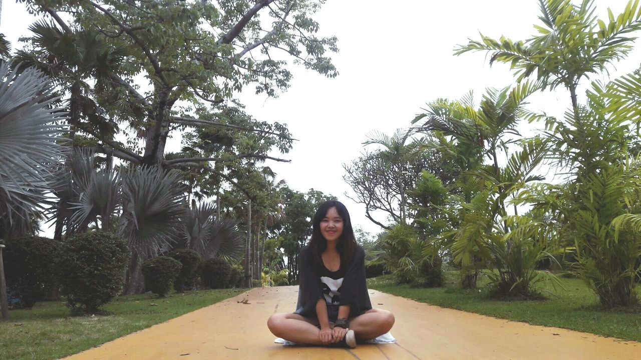 Only Women Tree One Woman Only Adult Sitting Yoga Women One Person Adults Only Front View People Full Length Cross-legged Relaxation Lifestyles Portrait Enjoyment Young Women Tranquility Looking At Camera