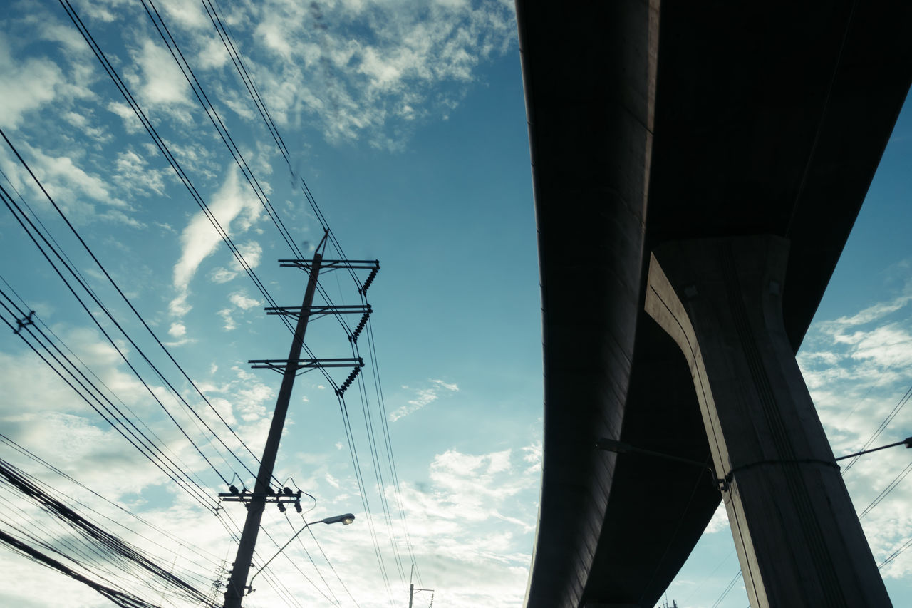 Cable Cloud - Sky Connection Day Electricity  Electricity Pylon Fuel And Power Generation Low Angle View Nature No People Outdoors Power Line  Power Supply Sky Technology Vapor Trail