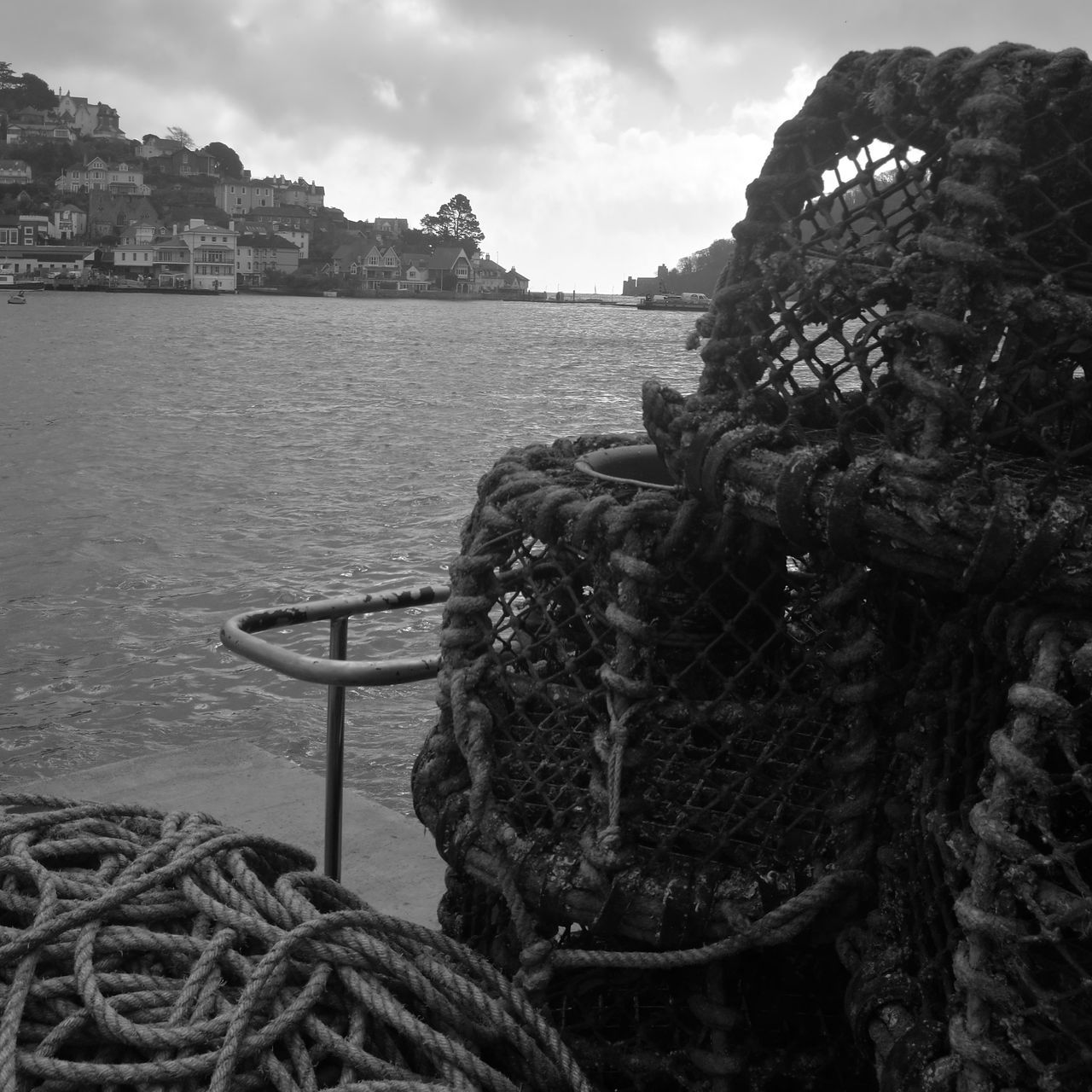 rope, sea, fishing net, water, strength, fishing equipment, fishing industry, no people, outdoors, harbor, tied up, sky, nautical vessel, tied knot, day, buoy, chain, moored, nature, fishing tackle, close-up