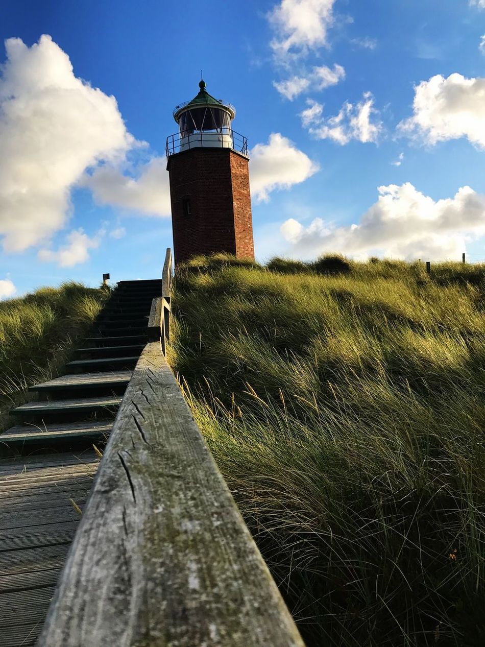 Lighthouse Guidance Sky Architecture Cloud - Sky Direction Grass Protection Built Structure Building Exterior Day Outdoors Nature No People IPhoneography Sylt Germany