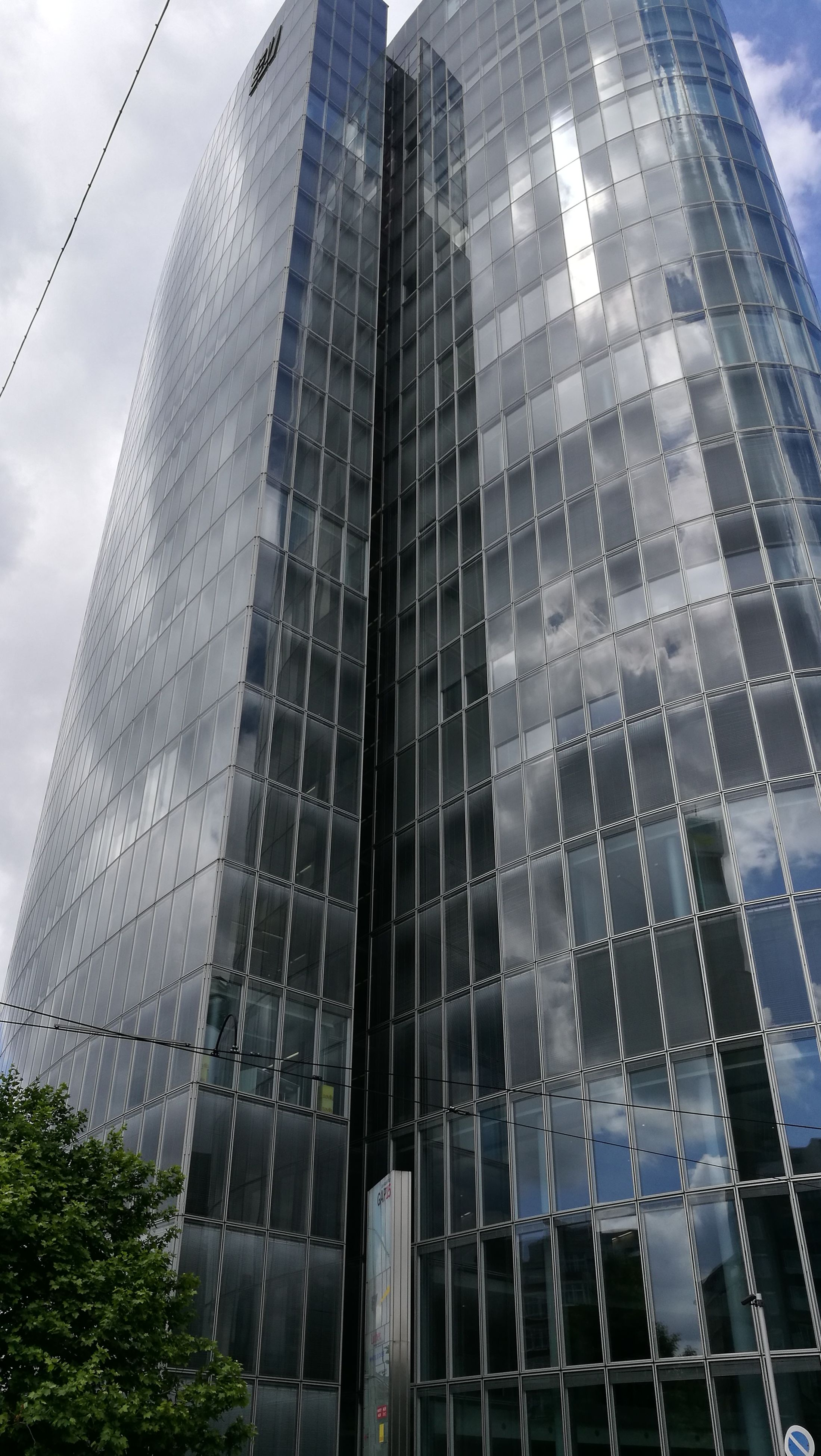 modern, architecture, low angle view, building exterior, skyscraper, sky, built structure, city, day, outdoors, no people, tall, growth