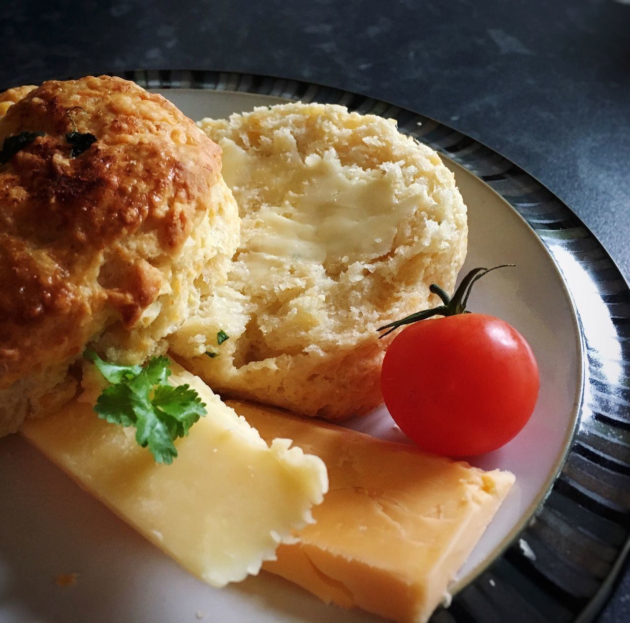 Close-Up Of Cheese Scones With Bread And Tomato
