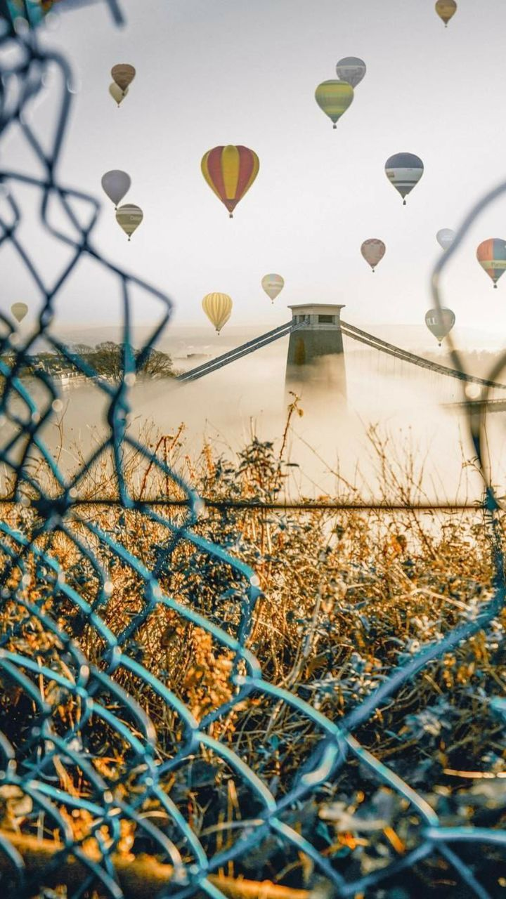 plant, no people, nature, built structure, sky, flying, building exterior, hot air balloon, day, outdoors, grass, architecture
