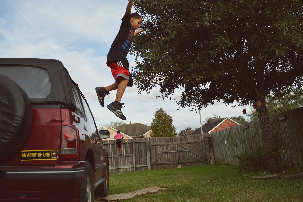 real people, one person, full length, lifestyles, leisure activity, jumping, transportation, tree, day, outdoors, men, motion, nature, architecture, building exterior, young adult, sky, adult, people