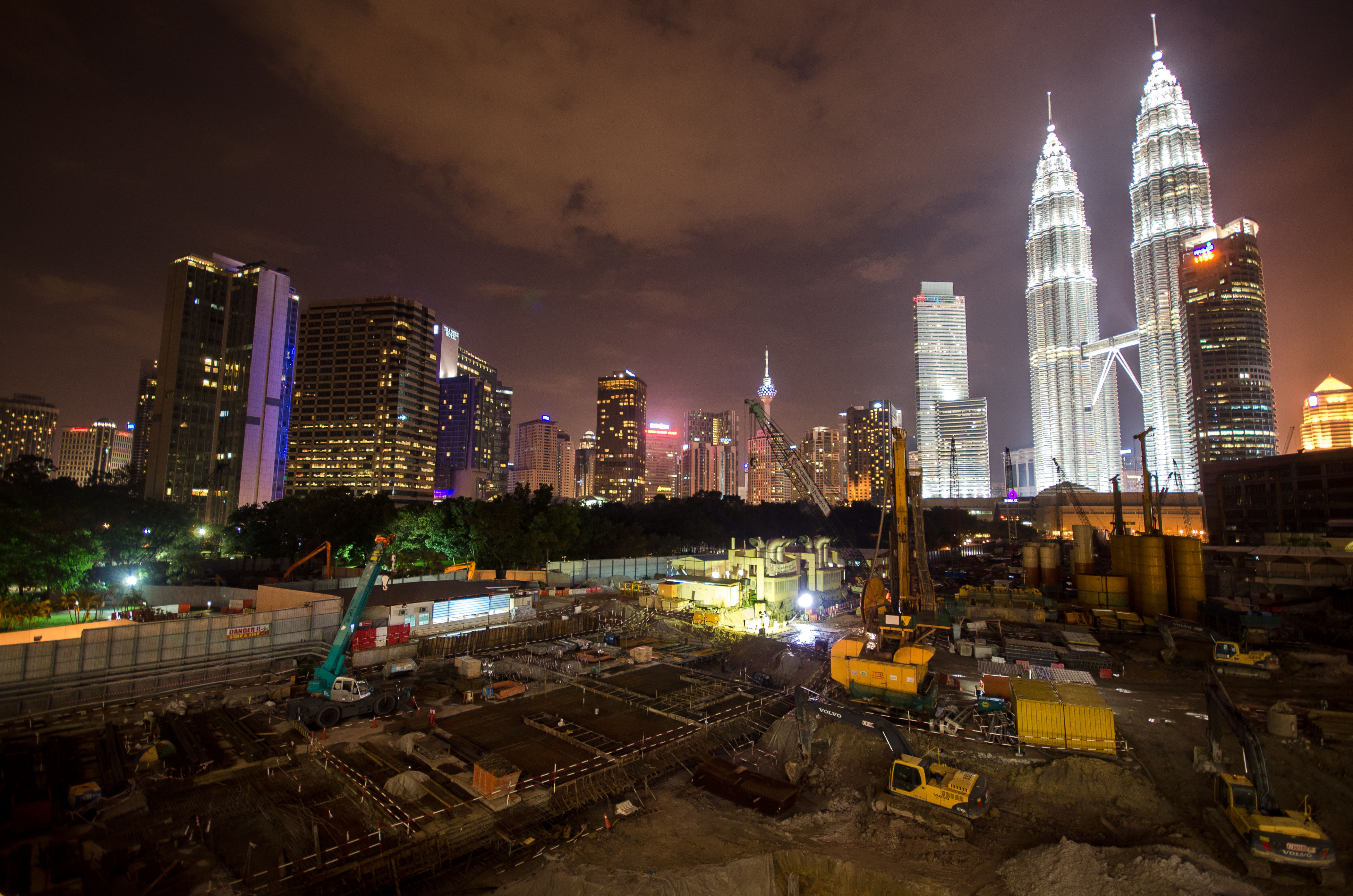 building exterior, architecture, city, built structure, illuminated, night, skyscraper, cityscape, tower, tall - high, sky, urban skyline, office building, modern, capital cities, city life, financial district, travel destinations, famous place, dusk