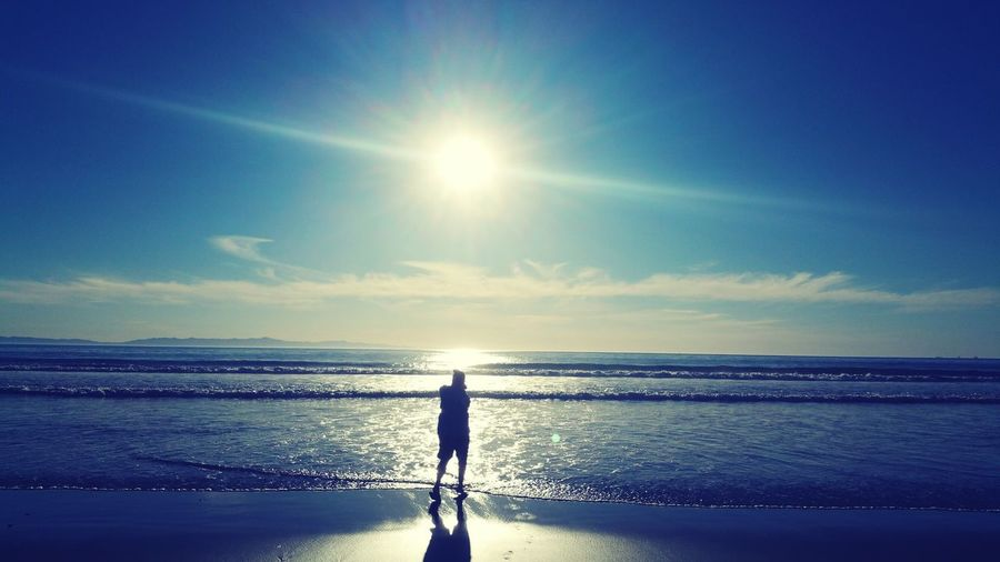Reflecting Sunlight Sun Tranquility One Person Horizon Over Water Beach Outdoors Coastline Reflection Shadow Posing Gazing At Nature EyeEmNewHere Women Around The World Long Goodbye