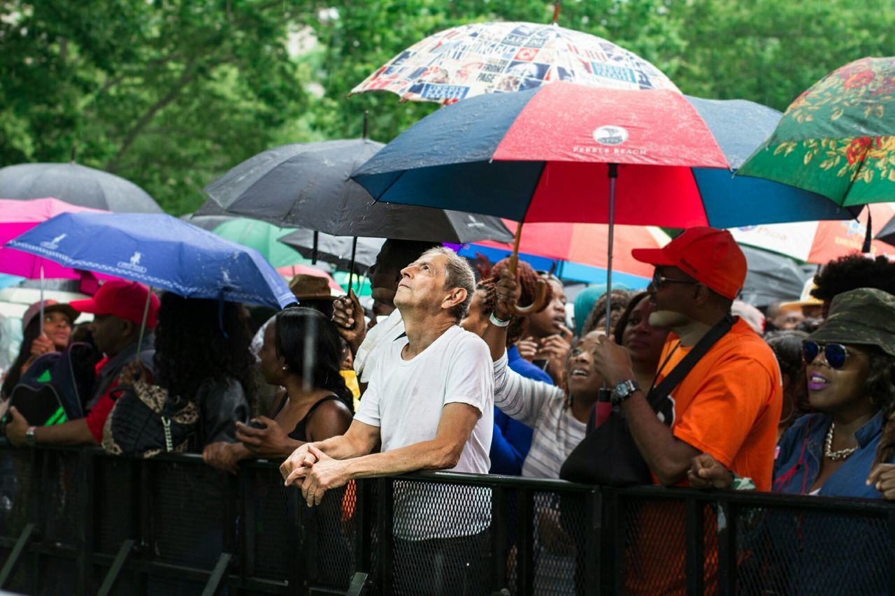 large group of people, protection, rain, crowd, people, outdoors, fun, enjoyment, shelter, day, adults only, summer, group of people, men, happiness, adult, women, cheerful, real people, only men, sky