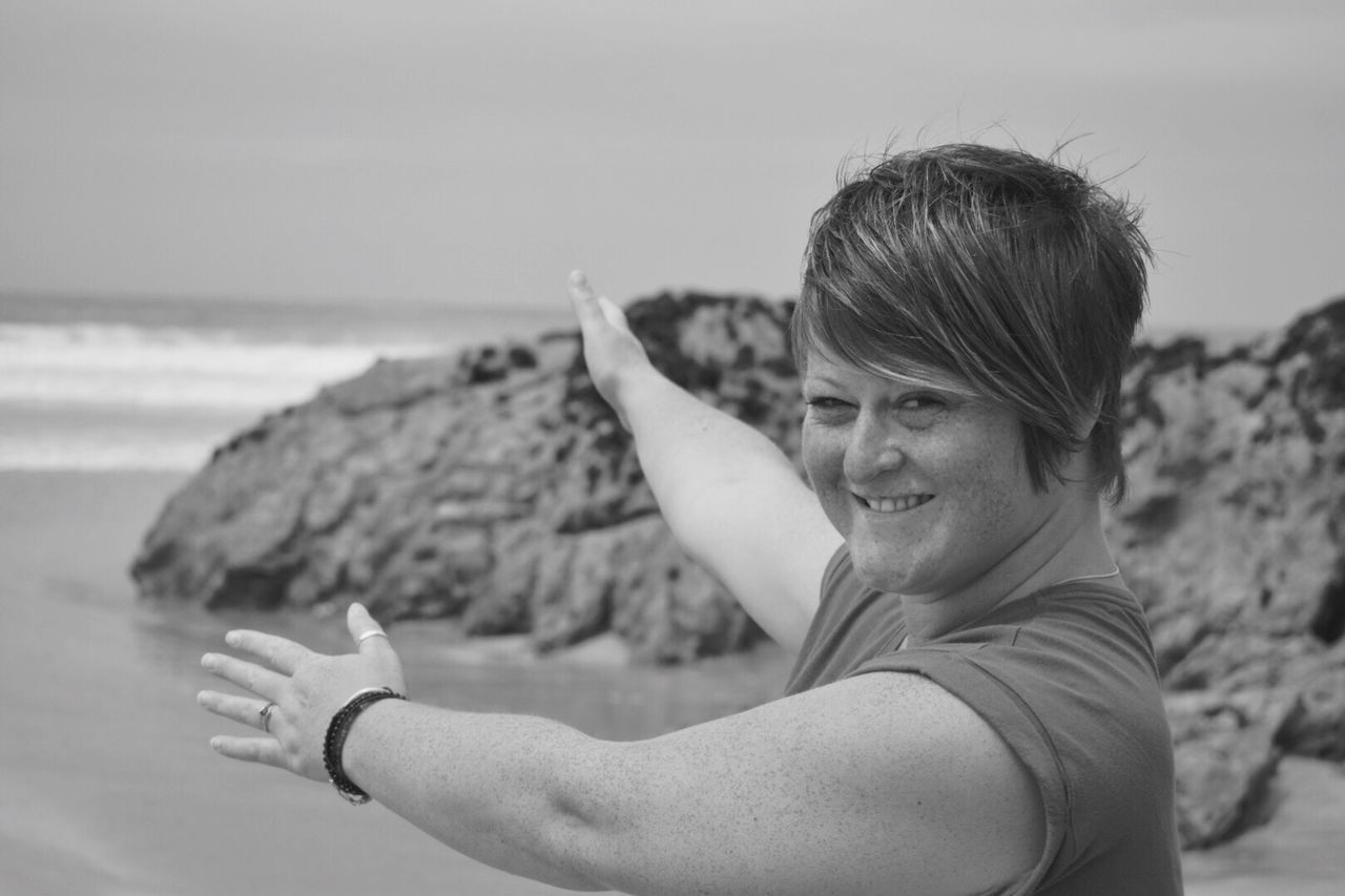One Person Beach Outdoors Portrait Of A Woman The Portraitist - 2017 EyeEm Awards Beachphotography Enjoying The Moment LOVING WHERE I LIVE Cornwall This Is Nature Posing For The Camera Summer Blackandwhite Cornwall Showing With Hands this way