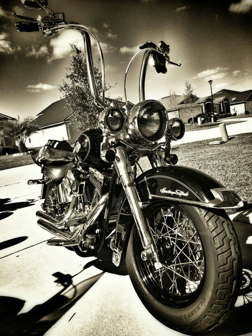 land vehicle, transportation, mode of transport, bicycle, wheel, motorcycle, stationary, parked, sky, outdoors, day, no people, cycle, cloud - sky