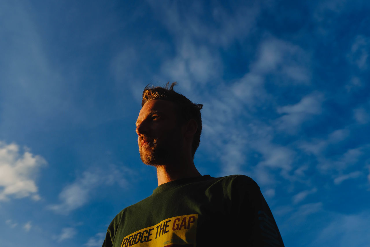 Cloud - Sky Day Headshot Low Angle View One Person Outdoors People Real People Sky Young Adult