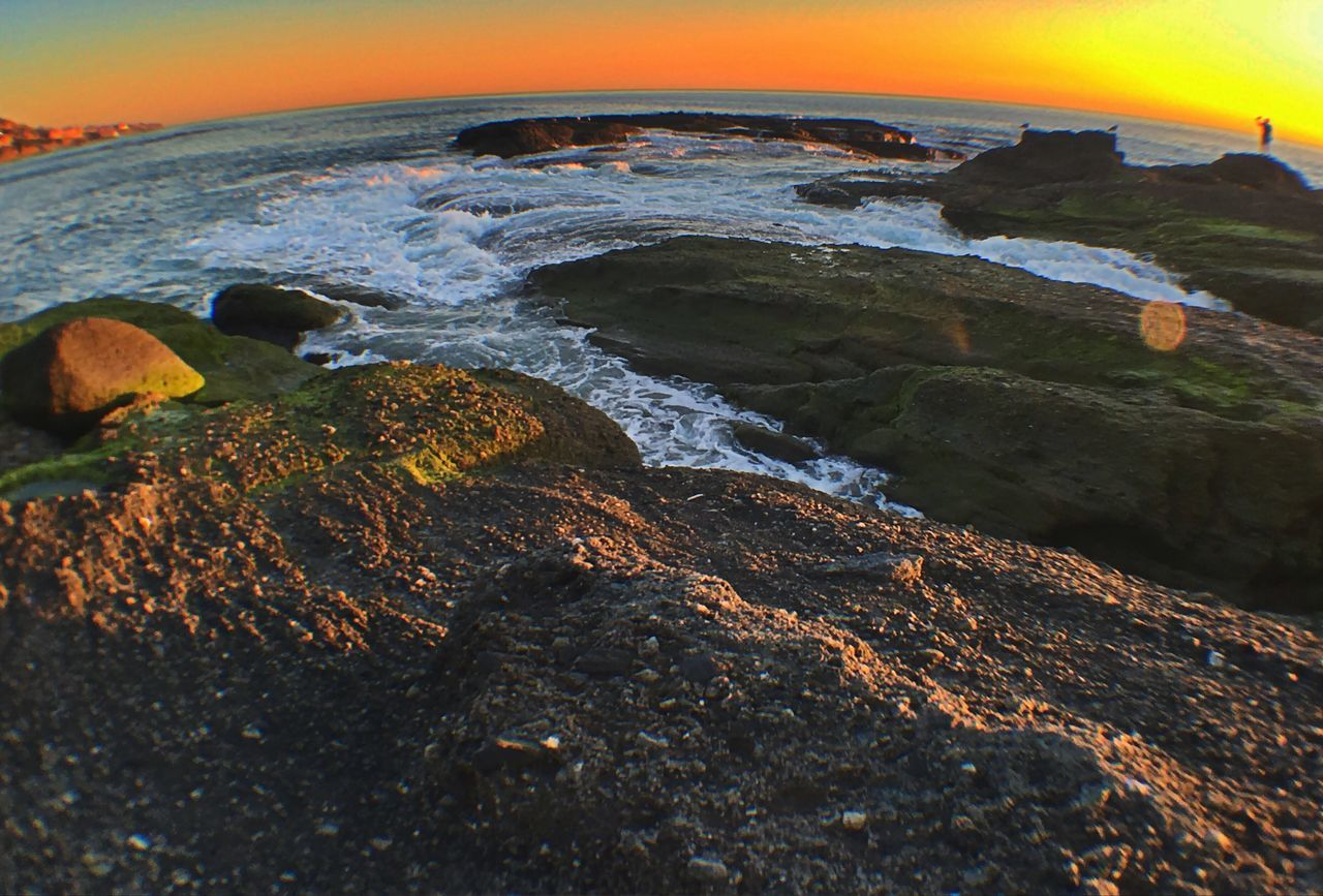 Sunset Ocean Beach Sea Nature Beauty In Nature Scenics Rock Rock - Object No People Horizon Over Water Outdoors Sky Wave Water Fish-eye Lens Day Scenic Lookout