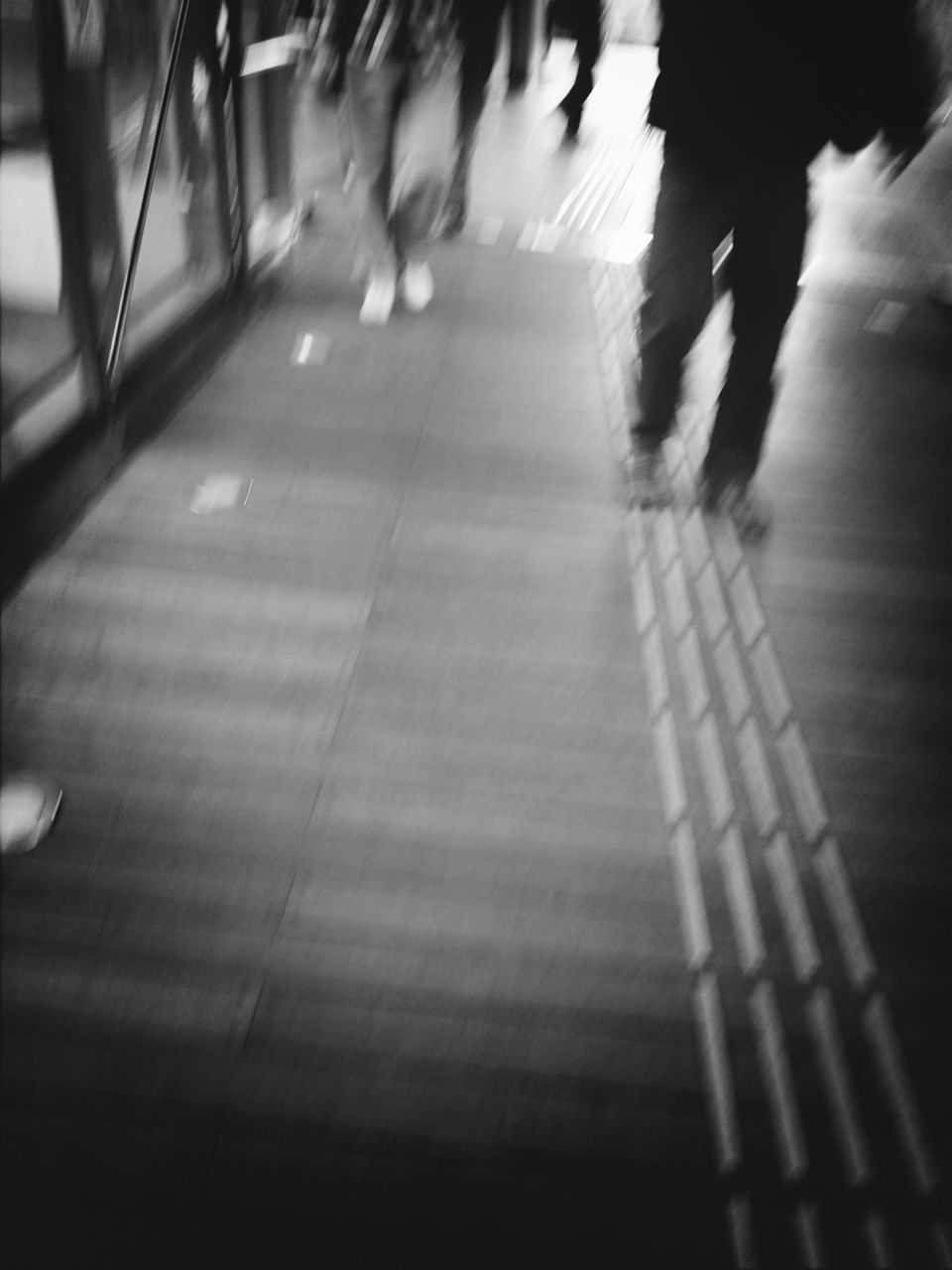 blurred motion, walking, real people, motion, speed, low section, men, large group of people, day, indoors, women, lifestyles, pedestrian, defocused, city, adult, people