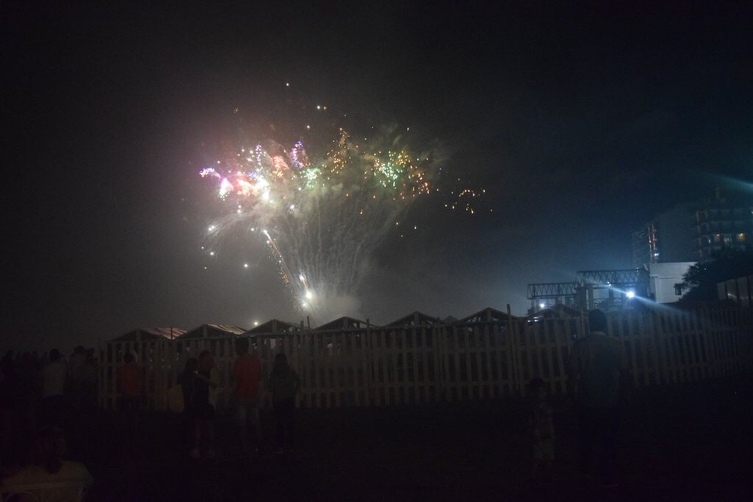 night, built structure, exploding, firework display, illuminated, architecture, building exterior, sky, firework - man made object, outdoors, celebration, event, arts culture and entertainment, cityscape, no people, city, firework