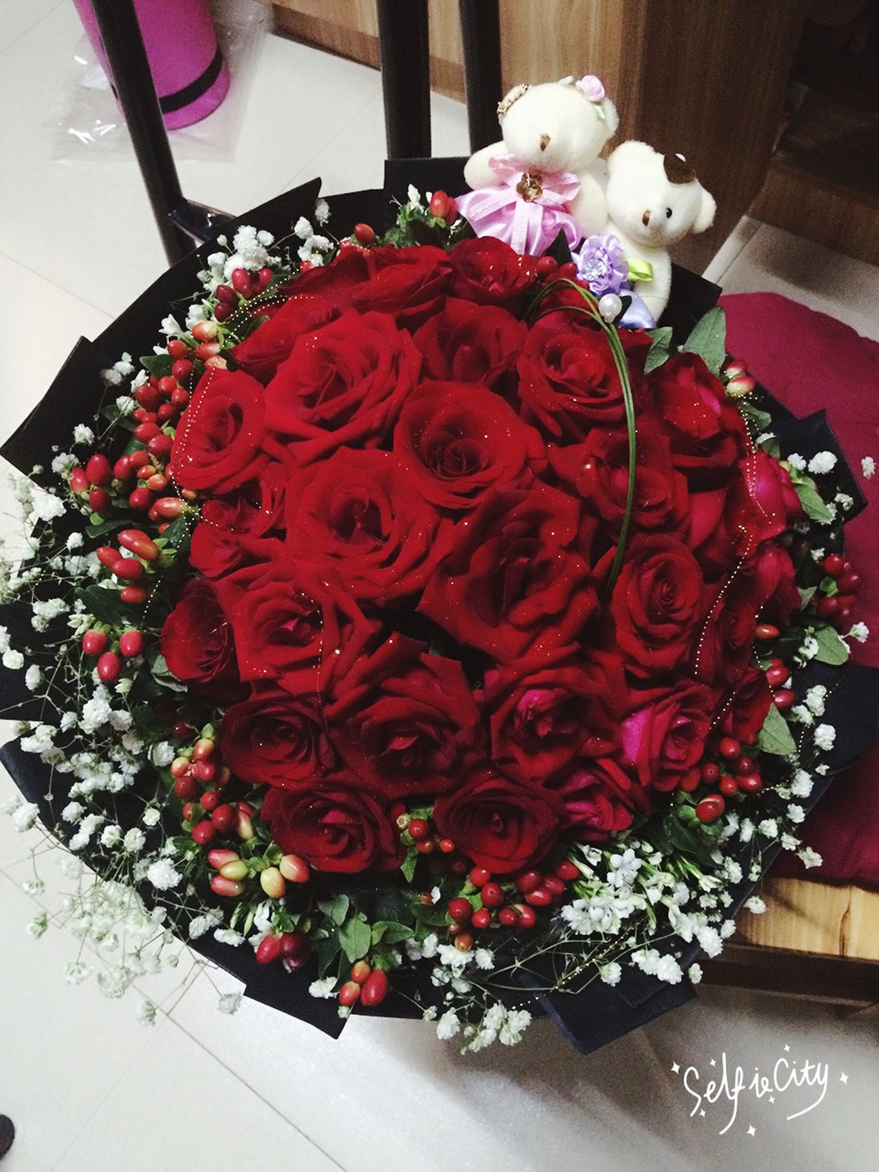 flower, indoors, decoration, freshness, fragility, petal, red, vase, bouquet, bunch of flowers, rose - flower, table, high angle view, home interior, flower head, flower arrangement, close-up, beauty in nature, pink color, no people
