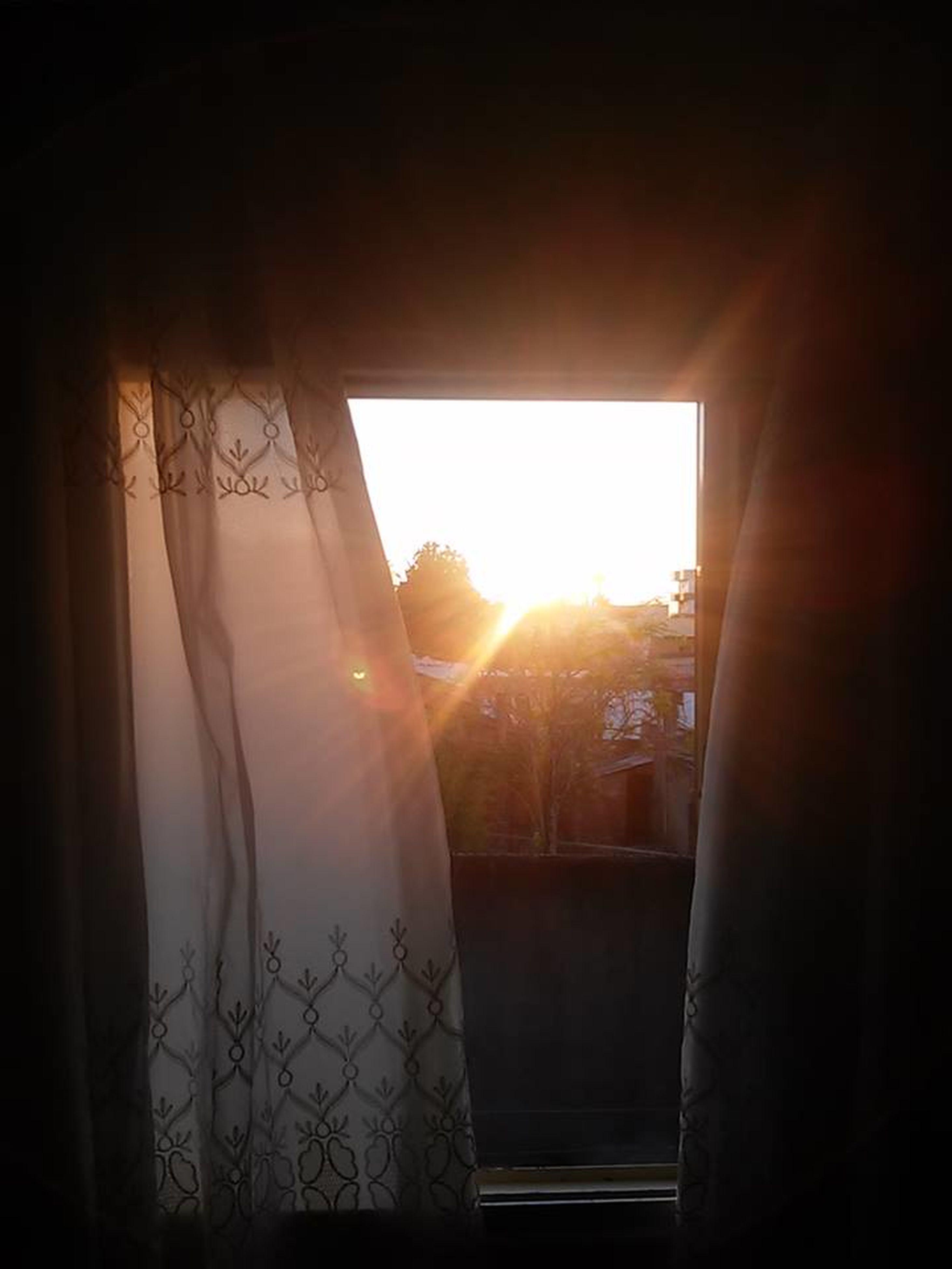 window, sunlight, sun, sunset, indoors, domestic room, sunbeam, no people, day, sky
