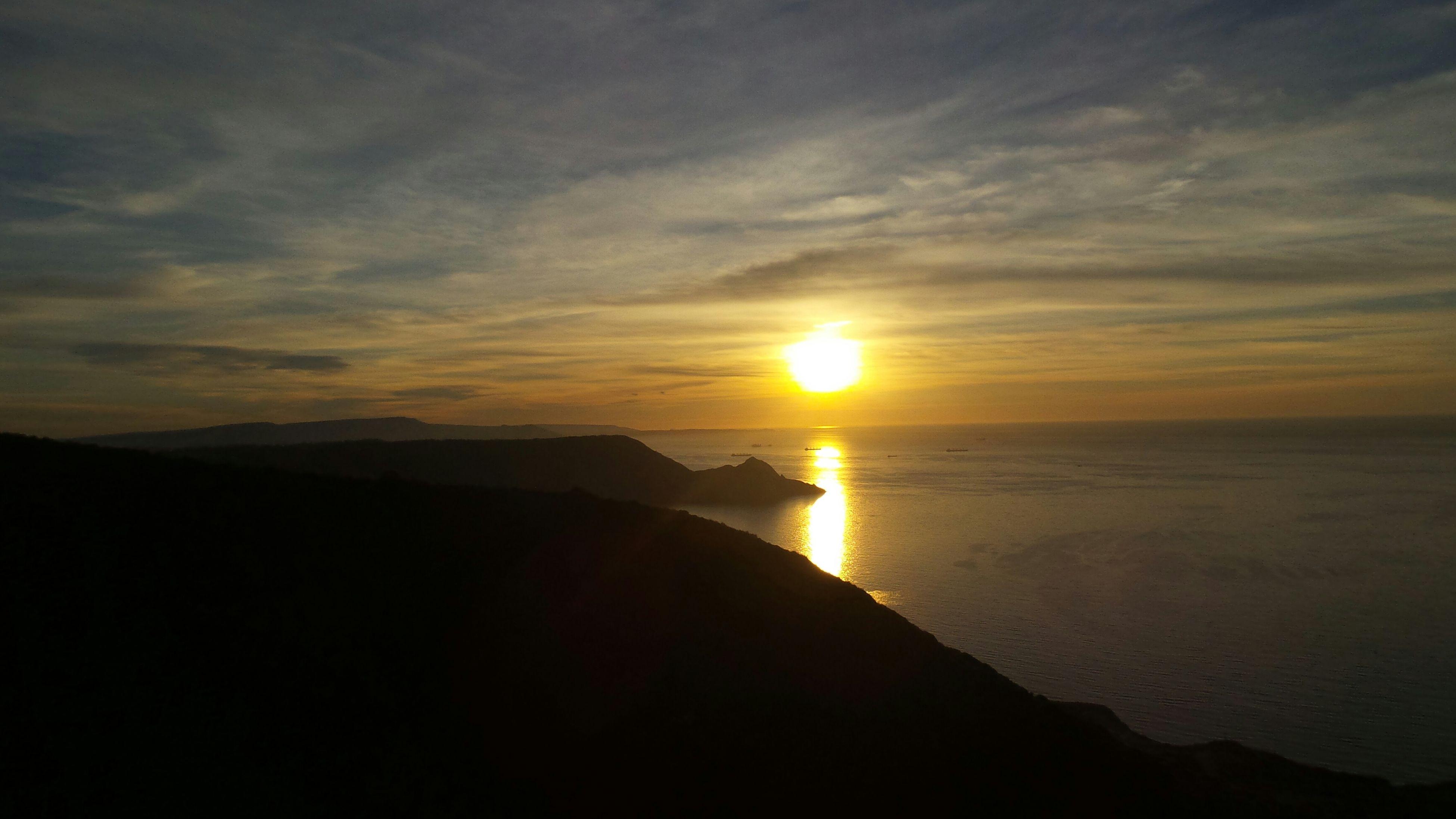 sunset, sea, sun, scenics, sky, tranquil scene, beauty in nature, tranquility, water, horizon over water, silhouette, cloud - sky, idyllic, nature, orange color, beach, mountain, sunlight, cloud, sunbeam