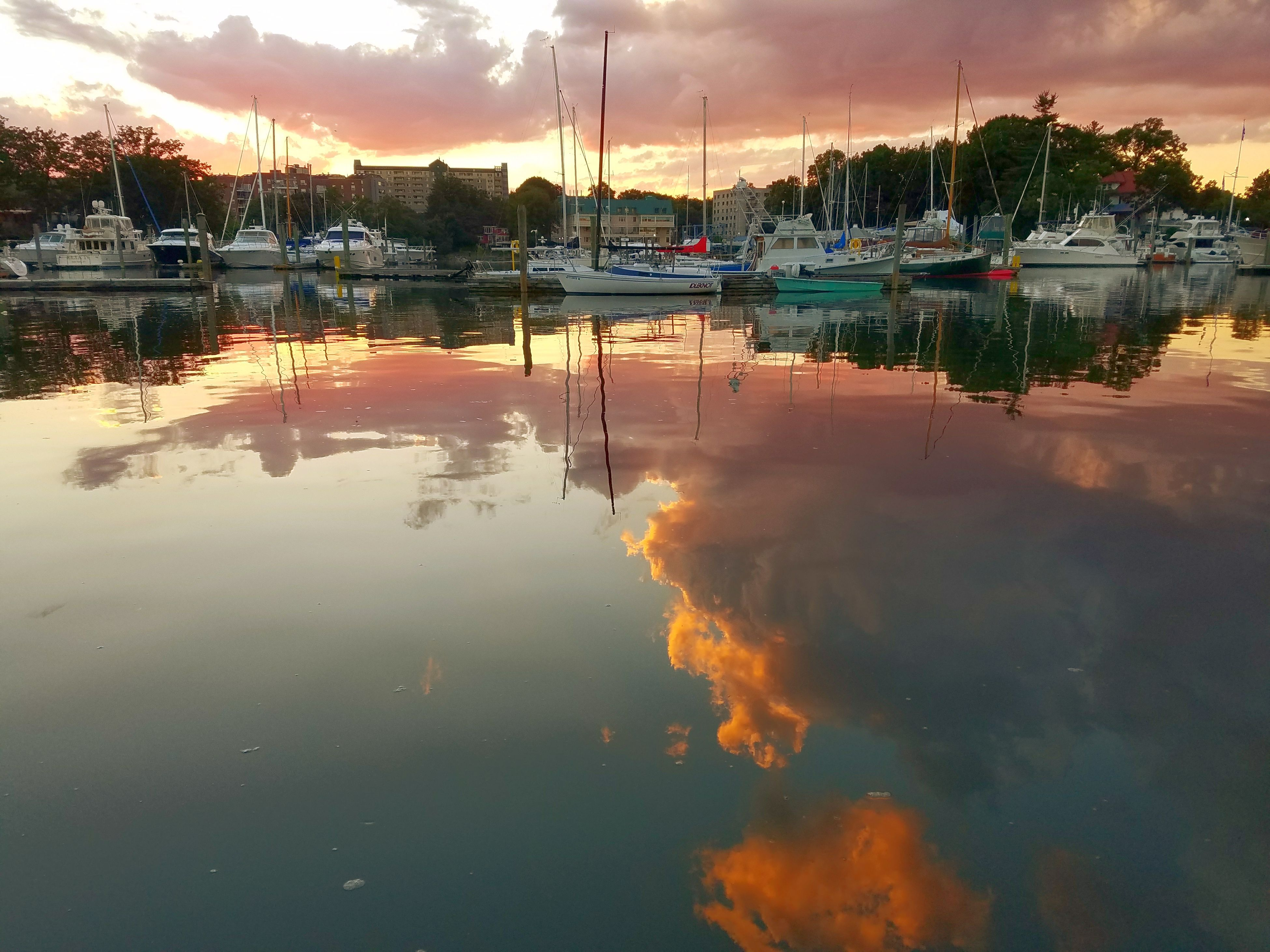 reflection, water, sky, nautical vessel, cloud - sky, waterfront, sunset, moored, no people, mode of transport, transportation, outdoors, nature, sea, building exterior, architecture, harbor, mast, tree, yacht, beauty in nature, day