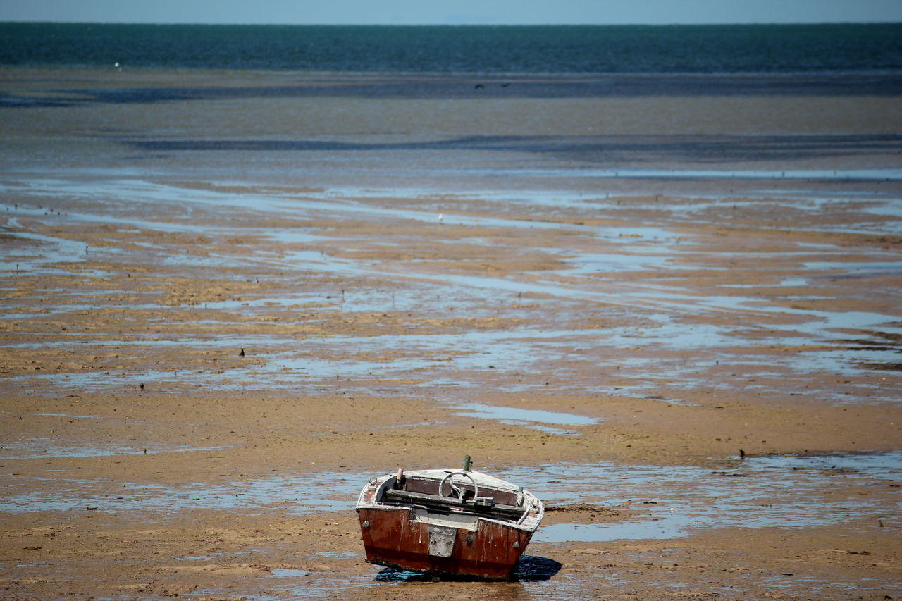Beach Sand Outdoors Mangroves Boat Nature Sea Water No People Beauty In Nature Day Adelaide, South Australia Beach Sand Car Outdoors Sunset Nature Sea Water No People Beauty In Nature Day