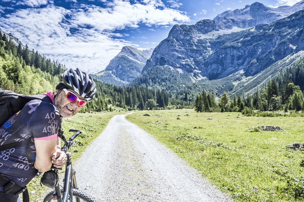Mountainbiker on tour in the Alps Activity Alps Austria Bayern Bike Biker Couple Cyclist E-bike Ebike Fitness Happy Holidays Ischgl Karwendel Mountain Mountainbike MTB Portrait Senior Smiling Sölden Tour Trail Vacation