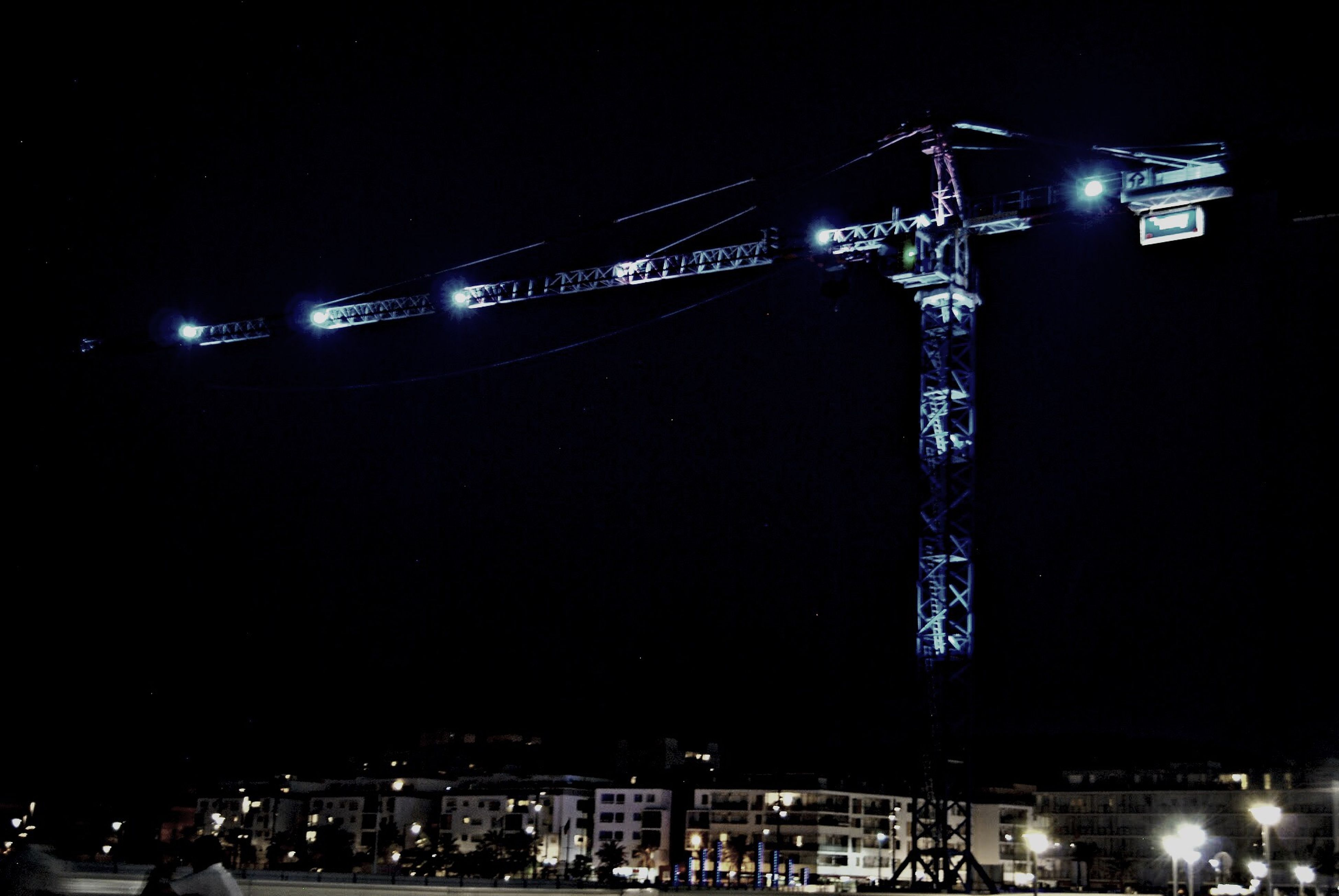 night, illuminated, built structure, architecture, city, transportation, bridge - man made structure, building exterior, engineering, clear sky, connection, water, river, copy space, travel destinations, sky, suspension bridge, low angle view, outdoors, travel
