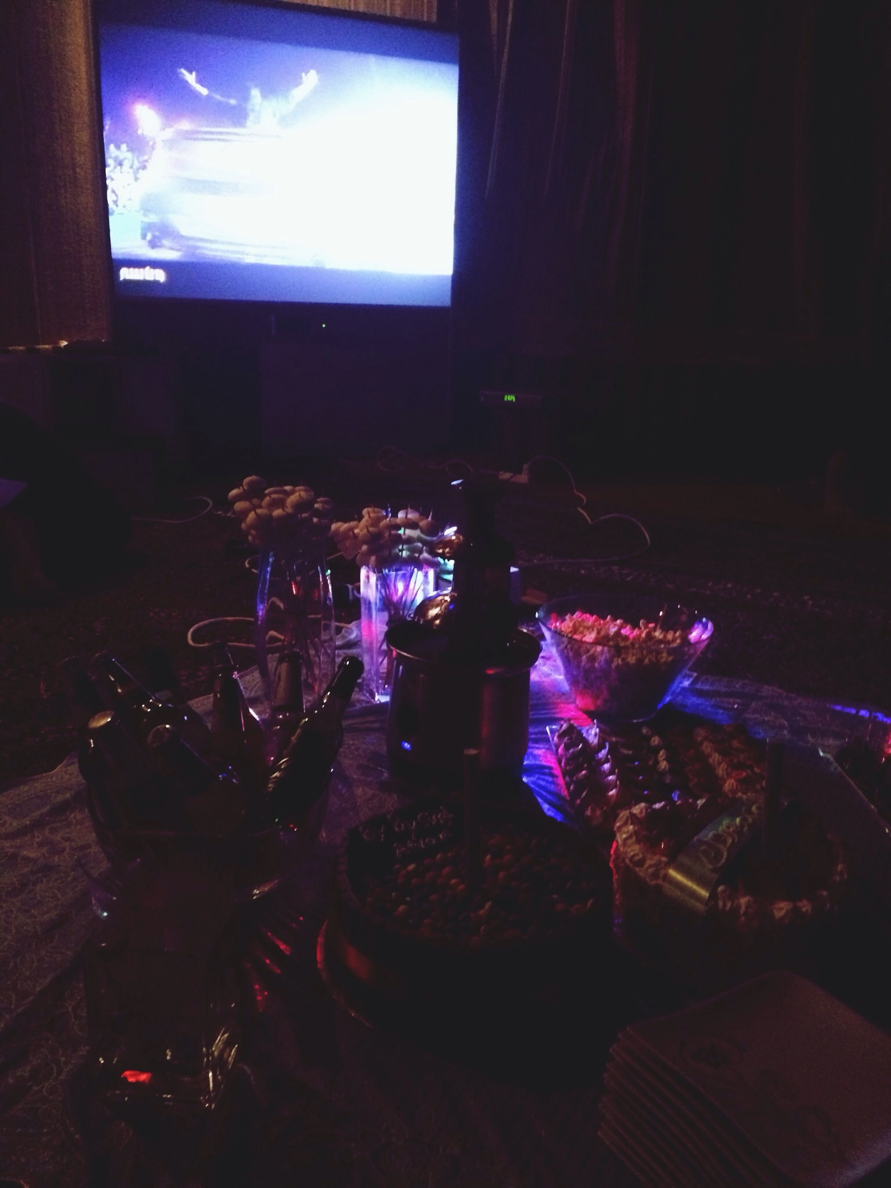 night, illuminated, indoors, dark, light - natural phenomenon, home interior, glowing, sitting, lighting equipment, sunlight, burning, shadow, purple, auto post production filter, celebration, relaxation, fire - natural phenomenon, room