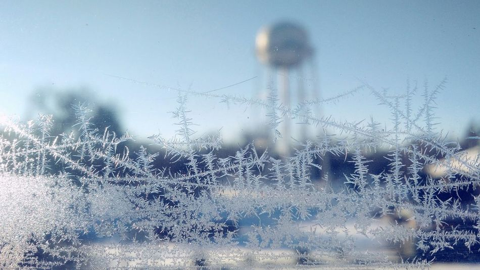Iced Window Frosted Glass Frostymorning Frosty Morning Small Town USA Close-up Window Focus On Foreground Ice Patterns Ice Crystals Winter Wonderland Winter Sky Winterscapes Winter Sun Water Tower Town Water Towers Water Tower Pics Water Tower Transparent Small Town Stories Small Town Landscape