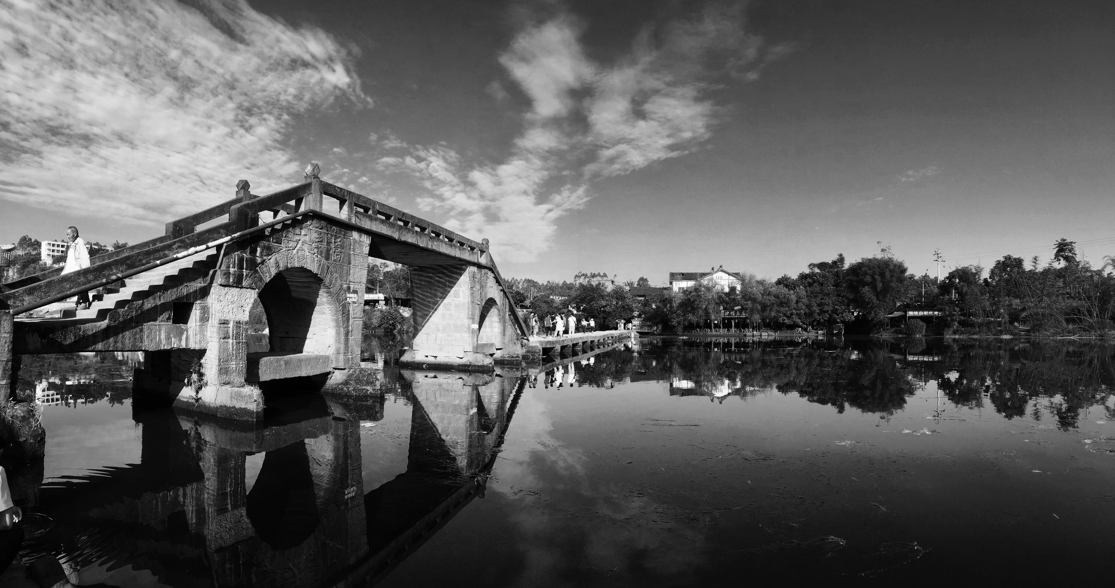 architecture, built structure, building exterior, water, reflection, sky, waterfront, cloud - sky, river, cloud, connection, standing water, lake, bridge - man made structure, day, outdoors, canal, building, house, residential structure